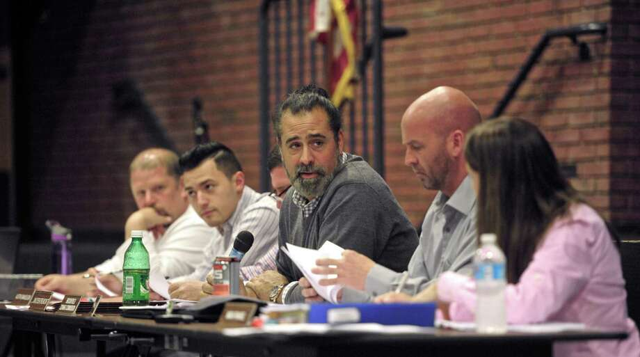 Zoning commission chairman Ryan Blessey, center, during the Brookfield zoning commission meeting on Thursday night, December 10, 2015, in Brookfield High School, Brookfield, Conn. Photo: H John Voorhees III / Hearst Connecticut Media / The News-Times