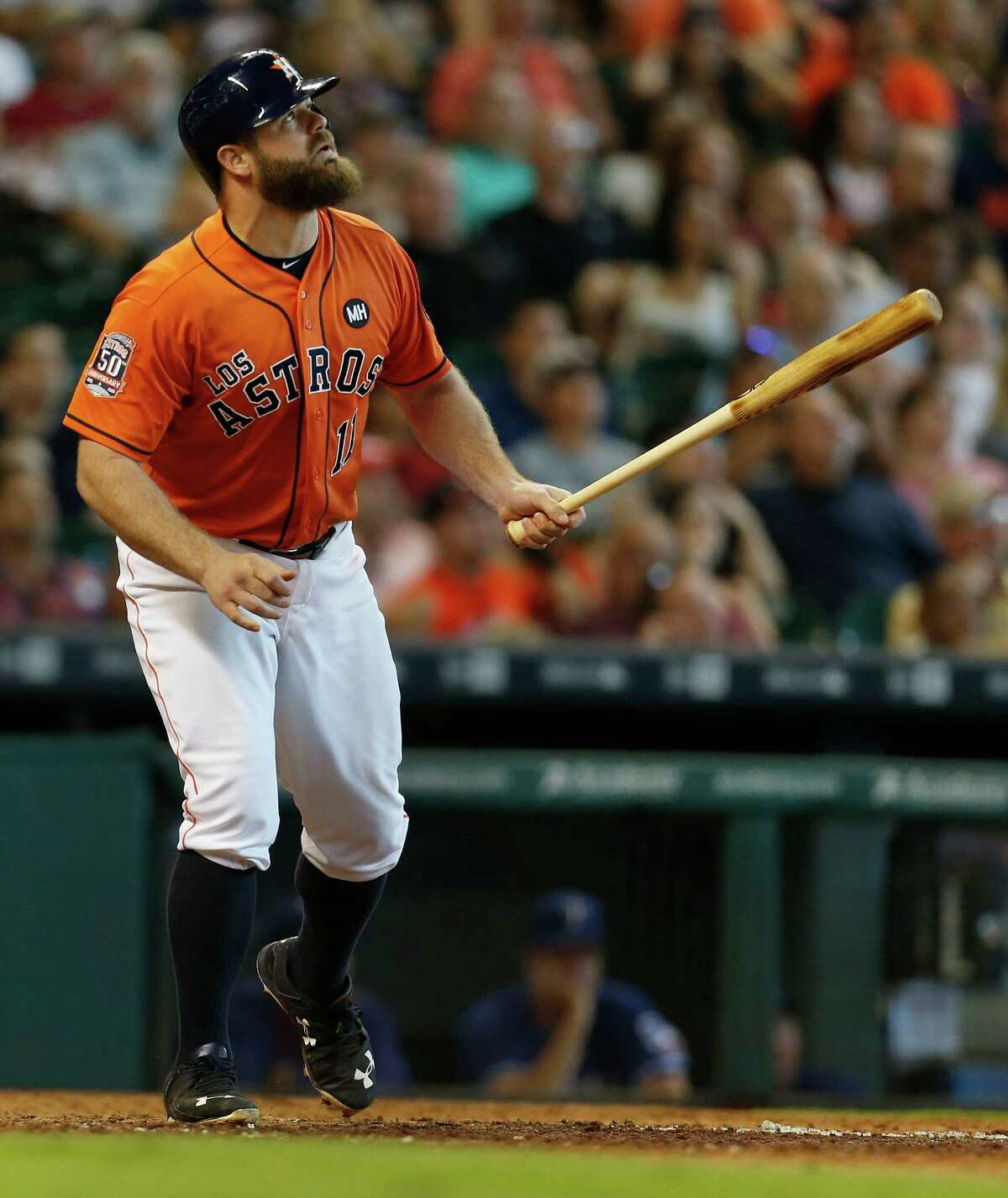Houston Astros designated hitter Evan Gattis (11) watches sacrifice fly during the 7th inning of an MLB game at Minute Maid Park on Saturday, Sept. 26, 2015. ( Karen Warren / Houston Chronicle )