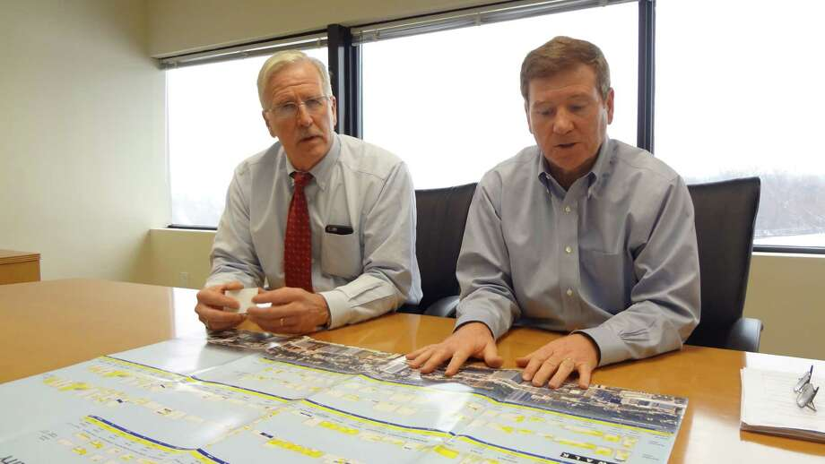 Alan Peterson and John Hannigan with the semiannual, floor-by-floor analysis of real estate vacancies in Stamford, Greenwich and Norwalk published by their commercial tenant representation firm Choyce Peterson. Photo: Alexander Soule / Hearst Connecticut Media / Stamford Advocate