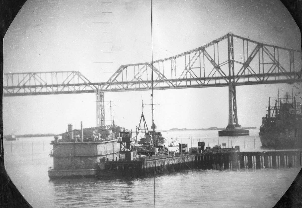 Jan. 21, 1951: A view from the U.S.S. Catfish submarine, taken near Treasure Island with the Bay Bridge in the distance.