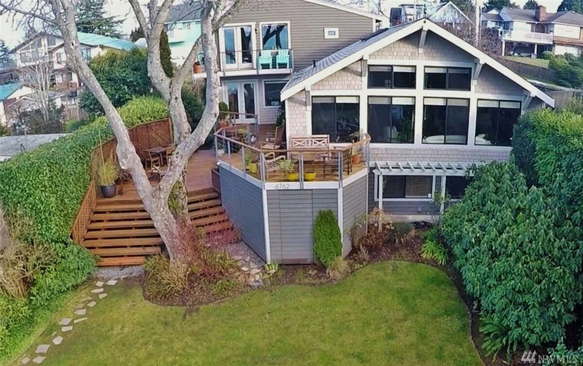 The home, 6762 38th Ave. S.W., is listed for $879,000. The four bedroom, 3.75 bathroom home boasts beautiful mountain and Puget Sound views from the living room. The home also has a fully remodeled kitchen and a master bedroom with its own wrap-around deck. You can see the full listing here.