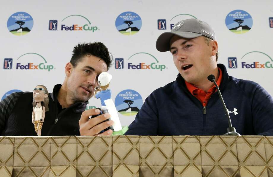 Playing partners Jake Owen, (left) and number one in the world Jordan Spieth check out thier bobbleheads of each of them duirng a press conference, on Wed. February 10, 2016, as they prepares for the AT&T Pebble Beach Pro-Am, in Pebble Beach, California. On Saturday 8,000 of the first fans to arrive for the tournament will receive a Jordan Spieth bobblehead. Jake Owen brought his own bobbleheads fron a previous event. Photo: Michael Macor