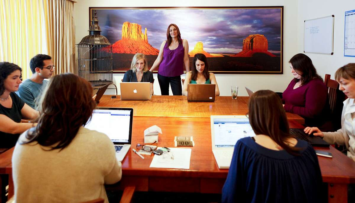 Nicole Daedone, former CEO and founder of OneTaste, poses with her staff in her Russian Hill home office on Wednesday, May 18, 2011 in San Francisco, Calif.