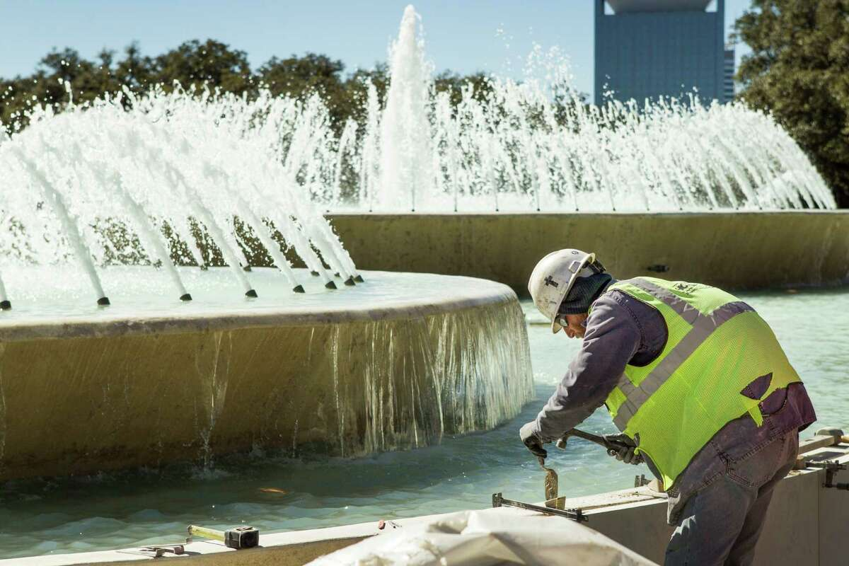 Limestone slabs are added to the sides of the Mecom Fountain construction at the intersection of Main and Montrose on Tuesday, Feb. 9, 2016, in Houston. The renovation is a part of Hermann Park's continuing reconstruction.