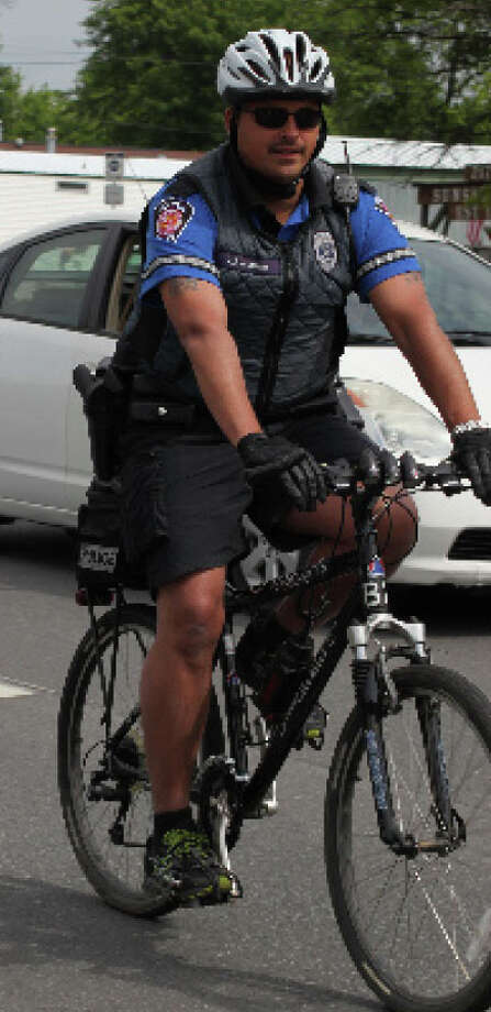 Colonie police officer Israel J. Roman from a 2012 report. (Colonie Police)