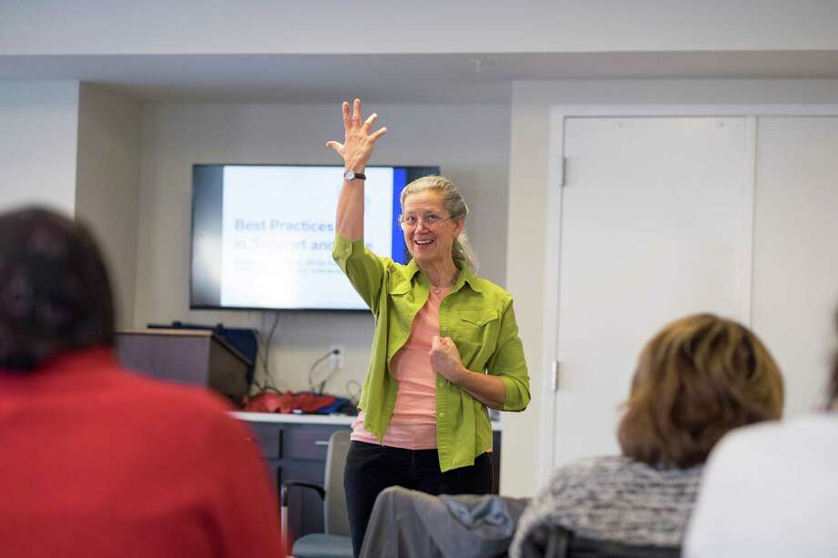 Teepa Snow, a nationally known Alzheimer's expert, conducts seminars where she uses humor, wit and wisdom to show participants what works best behaviorally when working with dementia patients. Here, Snow goes through a range of emotions during a role-playing exercise with seminar participants. Photo: Ed Hille / Philadelphia Inquirer / Philadelphia Inquirer