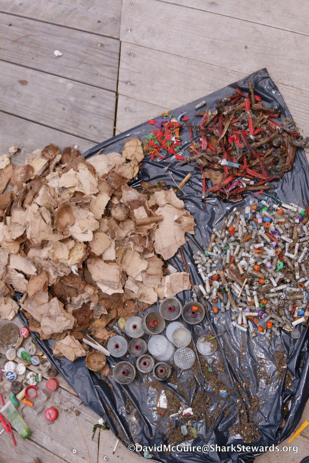 Volunteers picked up trash after Friday's Super Bowl fireworks show.