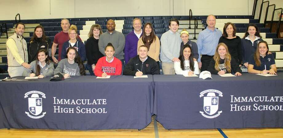 The Immaculate High School Athletic Department held its signing-day ceremony for student-athletes who will be playing their sports in college on Feb. 10, 2016. (Front row, from left) Maddy Wedvik will play lacrosse at St. Bonaventure; Hailey Davis will play soccer at Roanoke College; Mackenzie Mitchell will play soccer at Wesleyan University; Steve Bohling will play football at Williams College; Sara Al Khatib will swim at Georgia Tech; Caitlyn Linden will play soccer at Bryant University; and Shaun Alterisio will play soccer at Central Connecticut State University. Joining them in the ceremony were parents, coaches, guidance counselors, administrators and fellow students. Photo: Contributed Photo / News-Times Contributed