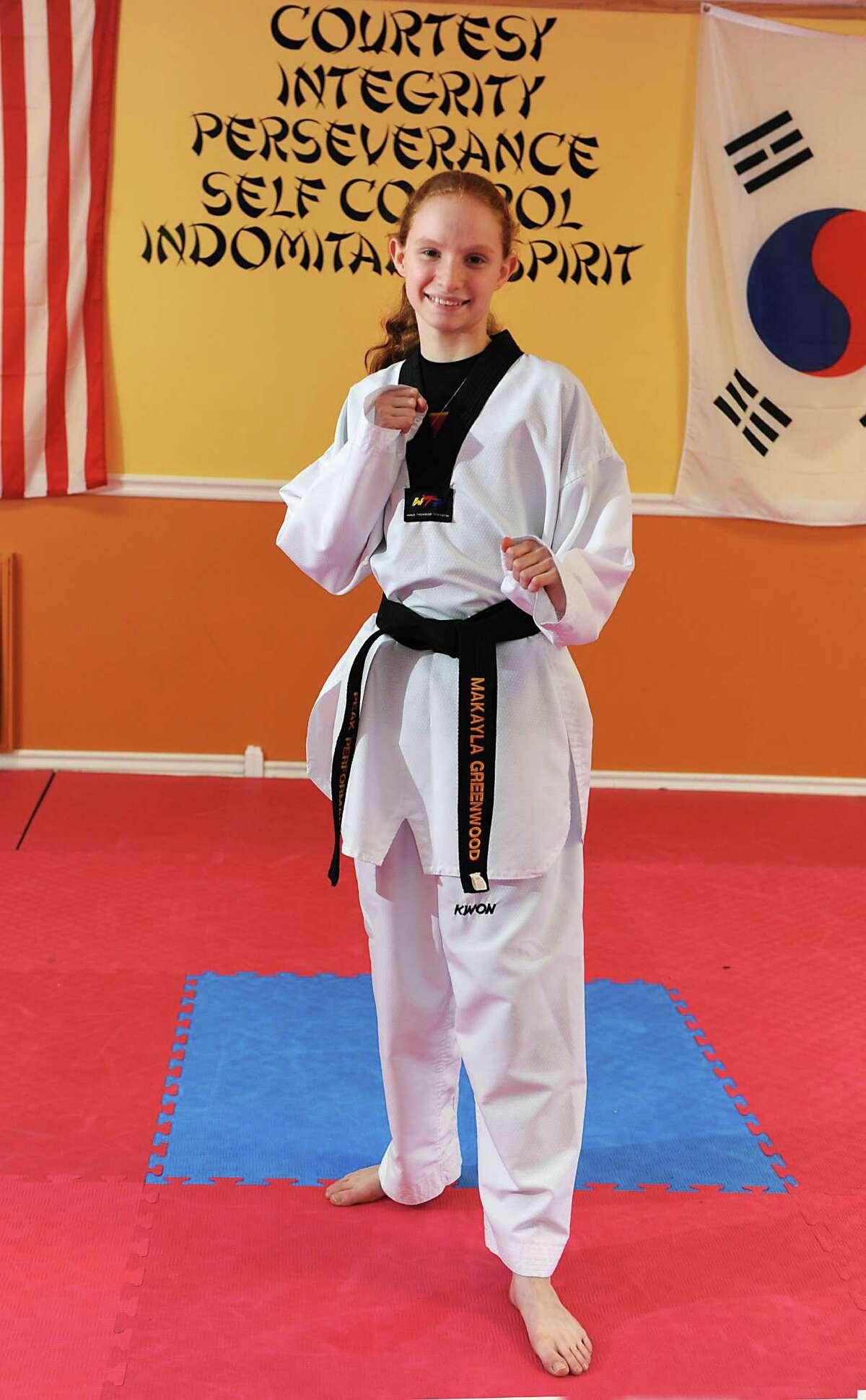 Taekwondo competitor Makayla Greenwood, 12, of Schenectady stands in Peak Performance where she trains Wednesday, Feb. 10, 2016 in Glenville, N.Y. Makayla recently took Gold at the 25th US International Taekwondo Open in Reno, Neveda. (Lori Van Buren / Times Union)