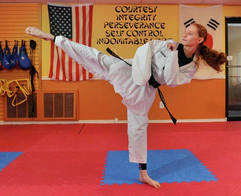 Taekwondo competitor Makayla Greenwood, 12, of Schenectady does a kick in Peak Performance where she trains Wednesday, Feb. 10, 2016 in Glenville, N.Y. Makayla recently took Gold at the 25th US International Taekwondo Open in Reno, Neveda. (Lori Van Buren / Times Union) Photo: Lori Van Buren / 10035374A