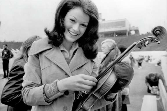TUNING UP FOR BIG SHOW-- Judy Mallett, the 1973 Miss Texas, and  her fiddle before the start of Super Bowl VIII on Jan. 13, 1974.  Mallett was a featured performer for the big half-time show at Rice Stadium.