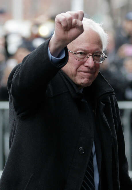 Democratic presidential candidate Sen. Bernie Sanders, I-Vt., raises a fist as he arrives for a breakfast meeting with Al Sharpton at Sylvia's Restaurant, Wednesday, Feb. 10, 2016, in the Harlem neighborhood of New York. Sanders defeated former Secretary of State Hillary Clinton on Tuesday in the New Hampshire primary. (AP Photo/Seth Wenig) Photo: Seth Wenig / Associated Press / AP
