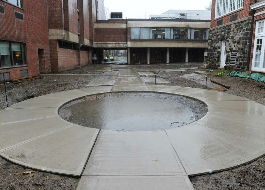Rain falls on the space where the friendship garden will connect with the indoor cafe at the Nathaniel Witherell rehabilitation center in April 2015. Photo: Tyler Sizemore / Tyler Sizemore / Greenwich Time