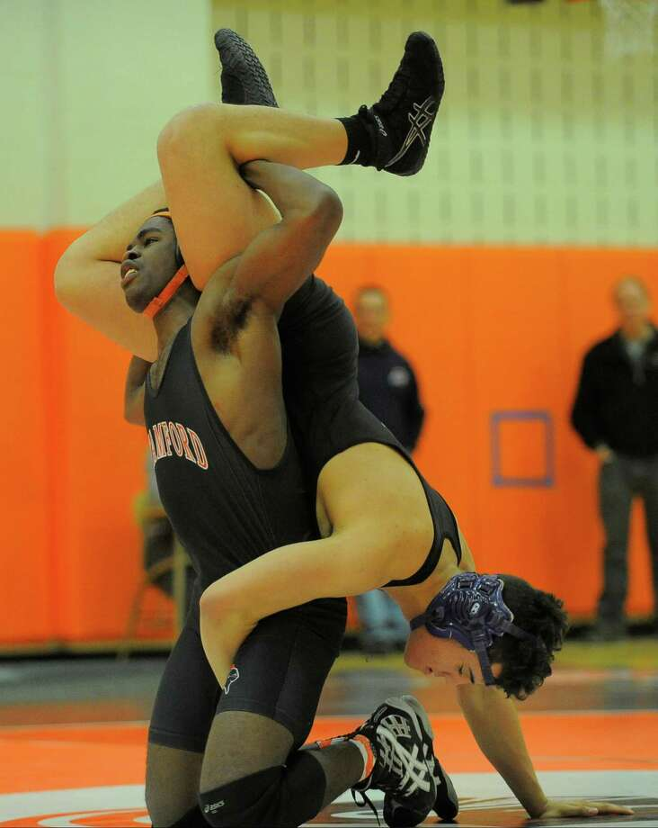 Westhill and Stamford battle it out in a FCIAC league dual meet at Stamford High School on Feb. 10, 2016. Westhill went on to defeat Stamford 42-28 to win the Stamford city championship. Photo: Matthew Brown, Hearst Connecticut Media / Stamford Advocate