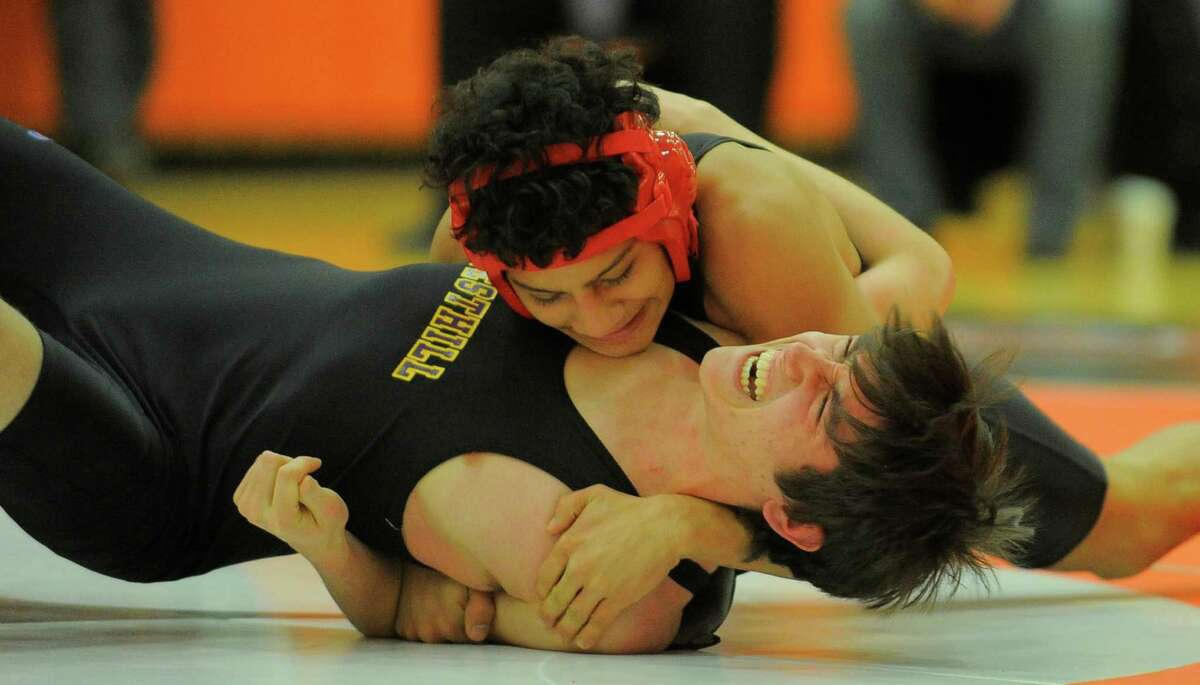 Stamford's Garey Mendez pins Westhill's Rodrigo Foley for the win at 2minutes 50 seconds during the 126 pound match of a FCIAC league dual meet at Stamford High School on Feb. 10, 2016. Westhill defeated Stamford 42-28 to win the Stamford city championship.