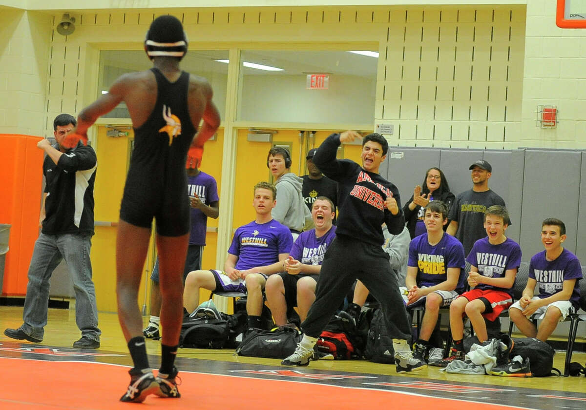 Westhill's Matthew Conte reacts to teammate Denver Dorsainvil's win over Stamford's Julius Page during the 138-pound bout during Wednesday's dual meet. Westhill defeated Stamford 42-28 to win the city championship.