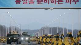Humvees cross the Tongil bridge, which leads to the Kaesong industrial park. South Korea said halting operations there would deprive the North of funds to develop nuclear and missile technology.