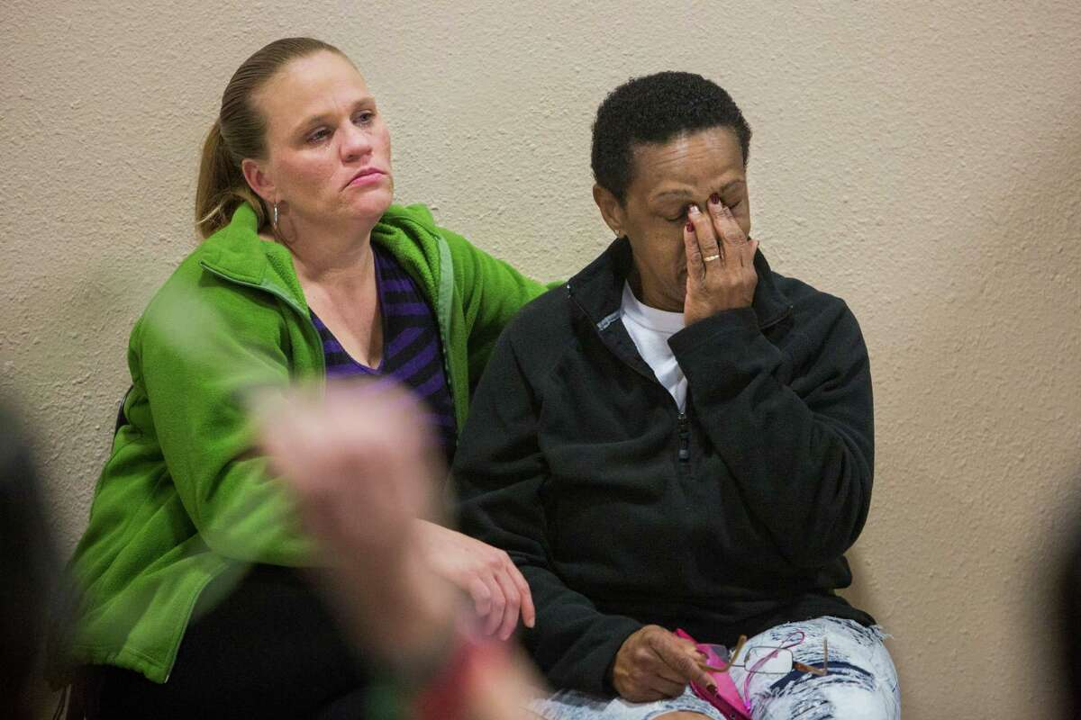 Kacie Herrick, left, comforts Diane Peppar during a press conference held at the Barbara Jordan Community Center about Antronie Scott's death in San Antonio, Texas on February 6, 2016. Herrick is Scott's stepsister and Peppar is Scott's mother. Scott, who was unarmed, was shot and killed by a San Antonio police officer outside of his car on Thursday evening as his wife watched from the passenger seat.