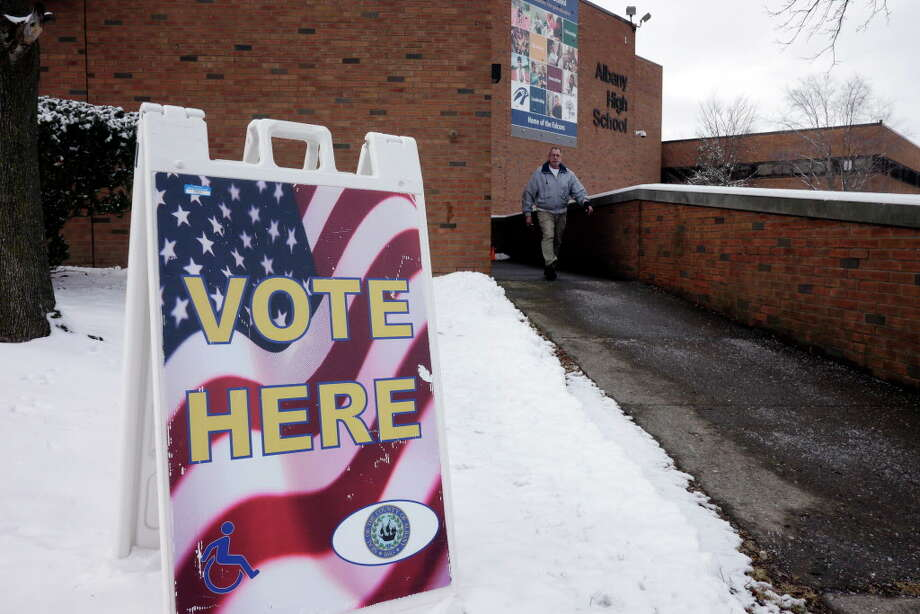A voter leaves the Albany High School as voting took place on the multimillion-dollar proposal to rebuild and expand the city's public high school on Tuesday, Feb. 9, 2016, in Albany, N.Y.   (Paul Buckowski / Times Union) Photo: PAUL BUCKOWSKI / 10035321A