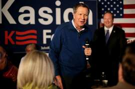 Ohio Gov. John Kasich, who claimed second place behind Donald Trump in the New Hampshire primary Tuesday, speaks to a capacity crowd at Finns Pizza in Mount Pleasant,S.C. Wednesday, Feb. 10, 2016. (Grace Beahm/The Post And Courier via AP)