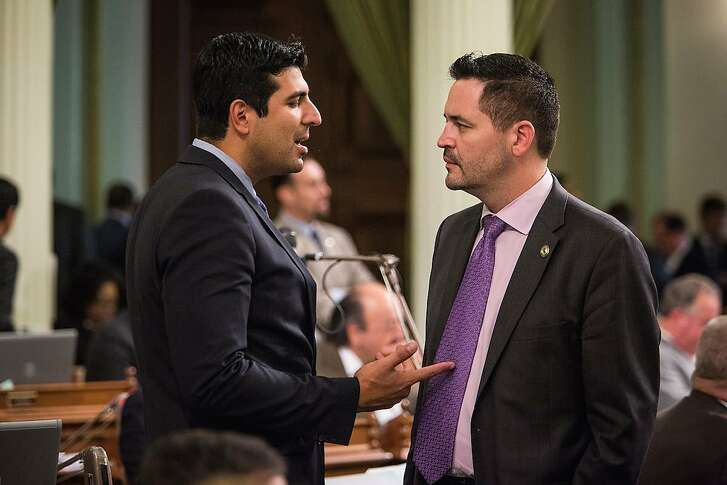 GOP Assemblyman Eric Linder, right, with Assemblyman Matt Dababheh. Assemblymember Matthew Dababneh (D-Van Nuys), left, and an unidentified assemblymember in the Assembly chambers, September 10, 2015 at the State Capitol in Sacramento, California.