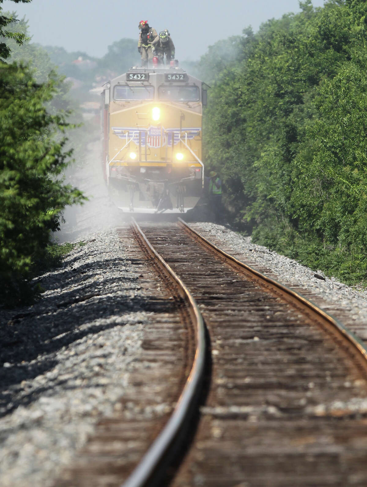 A Union Pacific freight train runs near Interstate 35 on a line the Lone Star Rail District had hoped to use for passenger trains. UP pulled out of an agreement to study that possibility, a blow to the district's plans to build a passenger rail line known as LSTAR between San Antonio and Georgetown, north of Austin.