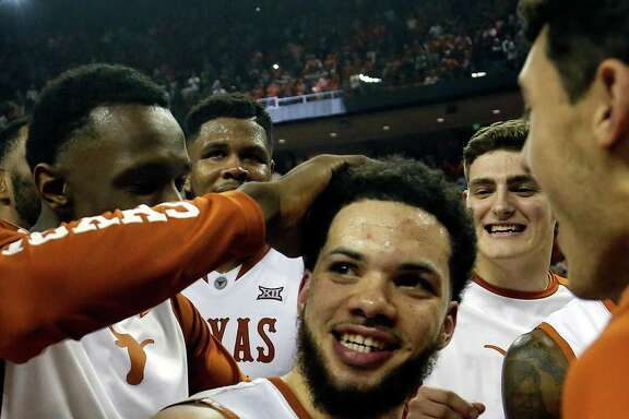 Javan Felix #3 of the Texas Longhorns is congratulated after making the shot to beat the North Carolina Tar Heels at the Frank Erwin Center on December 12, 2015 in Austin, Texas. (Photo by Chris Covatta/Getty Images)