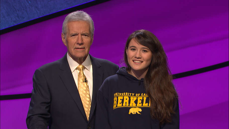 Niki Peters, 19, poses with Jeopardy! host Alex Trebek. The UC Berkeley sophomore will compete during the two-day Jeopardy! college championship finals this week.