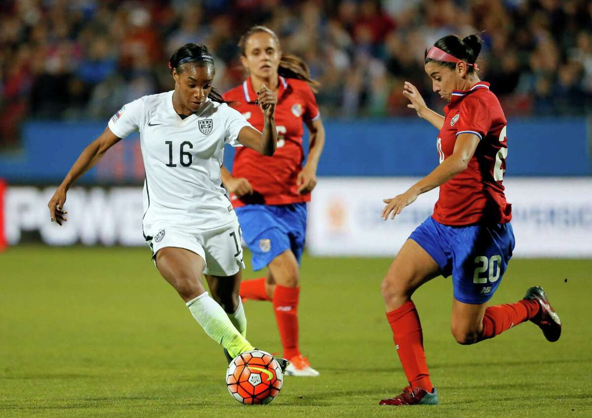 U.S. forward Crystal Dunn (16) controls the ball as Costa Rica midfielder Wendy Acosta (20) defends during the first half of a CONCACAF Olympic qualifying tournament soccer match Wednesday, Feb. 10, 2016, in Frisco, Texas. (AP Photo/Tony Gutierrez)