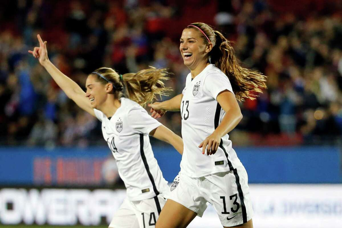 Unites States' Alex Morgan (13) and Morgan Brian (14) celebrate a goal scored by Morgan against Costa Rico during the first half of a CONCACAF Olympic qualifying tournament soccer match Wednesday, Feb. 10, 2016, in Frisco, Texas. (AP Photo/Tony Gutierrez)
