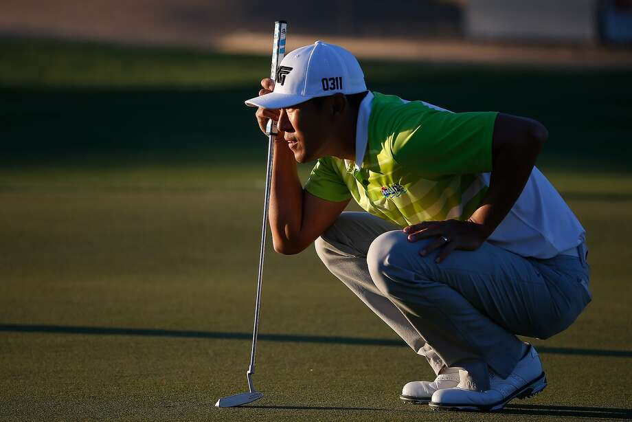 James Hahn lines up a putt at the Phoenix Open, where a too-quick swing on the weekend blew his lead. Photo: Christian Petersen, Getty Images