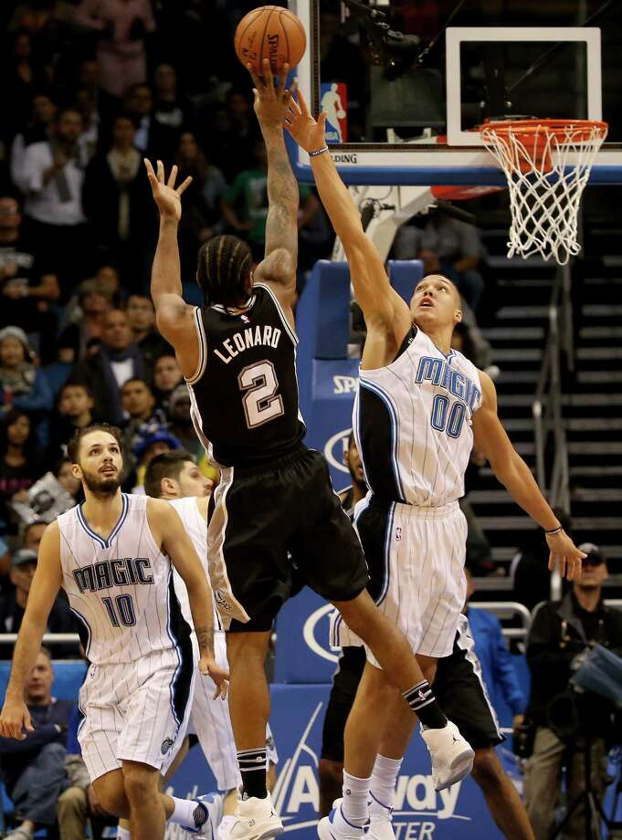 ORLANDO, FL - FEBRUARY 10:  Kawhi Leonard #2 of the San Antonio Spurs attempts a shot over Aaron Gordon #00 of the Orlando Magic during the game at Amway Center on February 10, 2016 in Orlando, Florida. Photo: Sam Greenwood, Getty Images / 2016 Getty Images