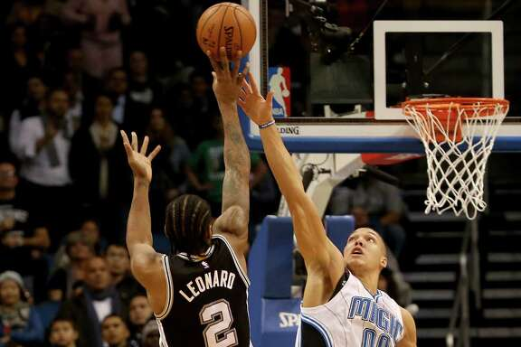 ORLANDO, FL - FEBRUARY 10:  Kawhi Leonard #2 of the San Antonio Spurs attempts a shot over Aaron Gordon #00 of the Orlando Magic during the game at Amway Center on February 10, 2016 in Orlando, Florida.
