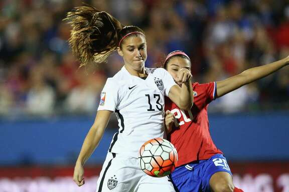 FRISCO, TX - FEBRUARY 10:  Alex Morgan #13 of USA scores a goal in the first minute of play against Wendy Acosta #20 of Costa Rica during the 2016 CONCACAF Women's Olympic Qualifying at Toyota Stadium on February 10, 2016 in Frisco, Texas.  (Photo by Ronald Martinez/Getty Images)