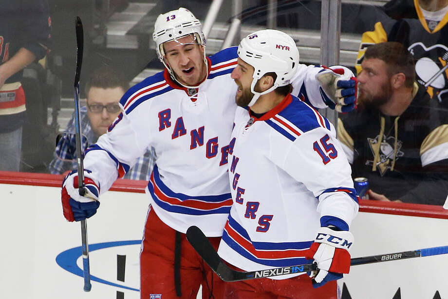 New York Rangers' Kevin Hayes (13) celebrates his goal with teammate Tanner Glass (15) during the first period of an NHL hockey game against the Pittsburgh Penguins in Pittsburgh, Wednesday, Feb. 10, 2016. (AP Photo/Gene J. Puskar) ORG XMIT: PAGP102 Photo: Gene J. Puskar / AP