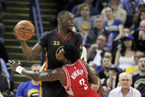 Patrick Beverly (2) tries to defend against Draymond Green (23) during the second half of the game between the Golden State Warriors and the Houston Rockets at Oracle Arena in Oakland, Calif., on Tuesday, February 9, 2016.  The Warriors won 123-110.