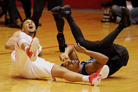 UH's Galen Robinson Jr., left, gets the worst of a confrontation with Memphis' Ricky Tarrant Jr.