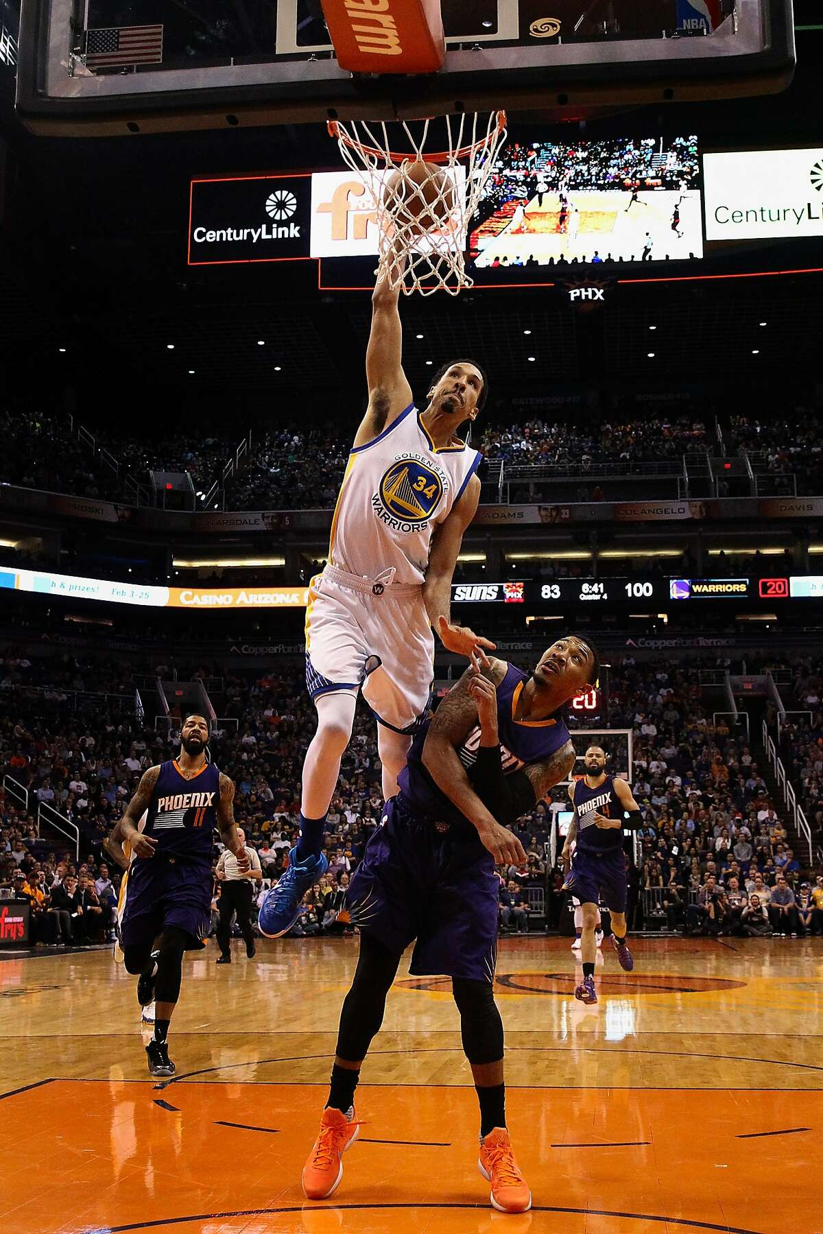 PHOENIX, AZ - FEBRUARY 10: Shaun Livingston #34 of the Golden State Warriors attempts a slam dunk over Orlando Johnson #0 of the Phoenix Suns during the second half of the NBA game at Talking Stick Resort Arena on February 10, 2016 in Phoenix, Arizona. The Warriors defeated the Suns 112-104. NOTE TO USER: User expressly acknowledges and agrees that, by downloading and or using this photograph, User is consenting to the terms and conditions of the Getty Images License Agreement. (Photo by Christian Petersen/Getty Images)