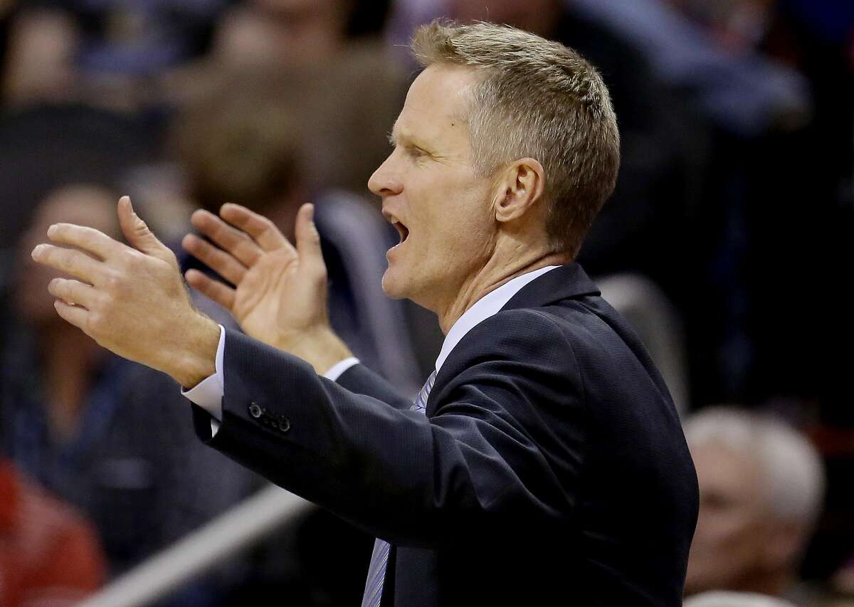 Golden State Warriors coach Steve Kerr reacts to a call during the second half of the Warriors' NBA basketball game against the Phoenix Suns, Wednesday, Feb. 10, 2016, in Phoenix.