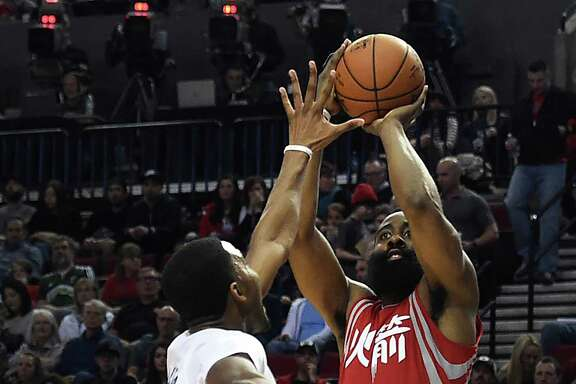 Houston Rockets guard James Harden (13) shoots the ball over Portland Trail Blazers forward Maurice Harkless (4) during the second half of an NBA basketball game in Portland, Ore., Wednesday, Feb. 10, 2016. (AP Photo/Steve Dykes)