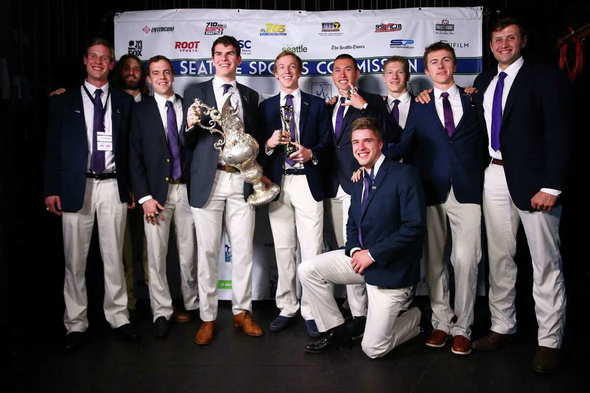 The UW Men's Crew Team pose with their 2016 Sports Story of the Year trophy during the 2016 MTRWestern Sports Star of the Year Awards, Wednesday, Feb. 10, 2016 at the Paramount Theater. The team won their fifth consecutive national title this year.