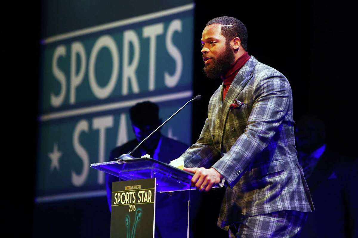 Michael Bennett accepts the 2016 Male Sports Star of the Year Award during the 2016 MTRWestern Sports Star of the Year Awards, Wednesday, Feb. 10, 2016 at the Paramount Theater.
