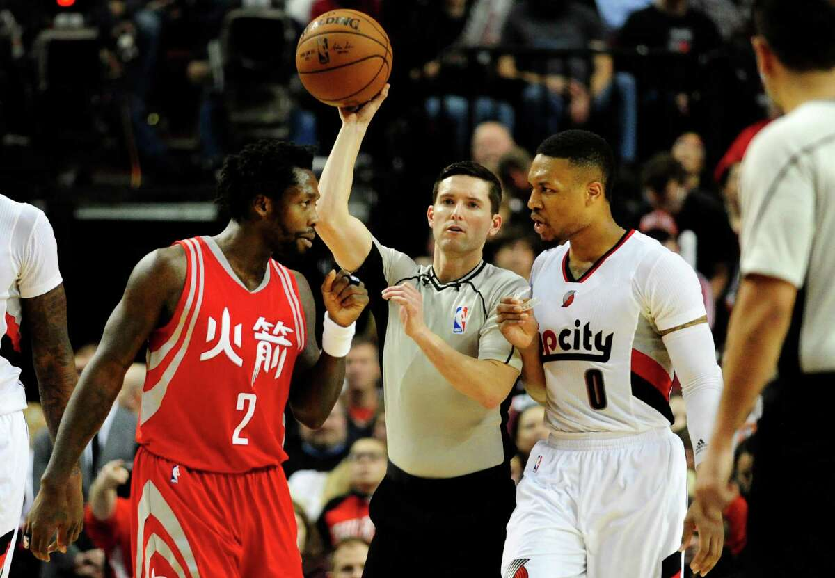 Houston Rockets guard Patrick Beverley (2) has some words with Portland Trail Blazers guard Damian Lillard (0) during the second half of an NBA basketball game in Portland, Ore., Wednesday, Feb. 10, 2016. The Blazers won 116-103. (AP Photo/Steve Dykes)