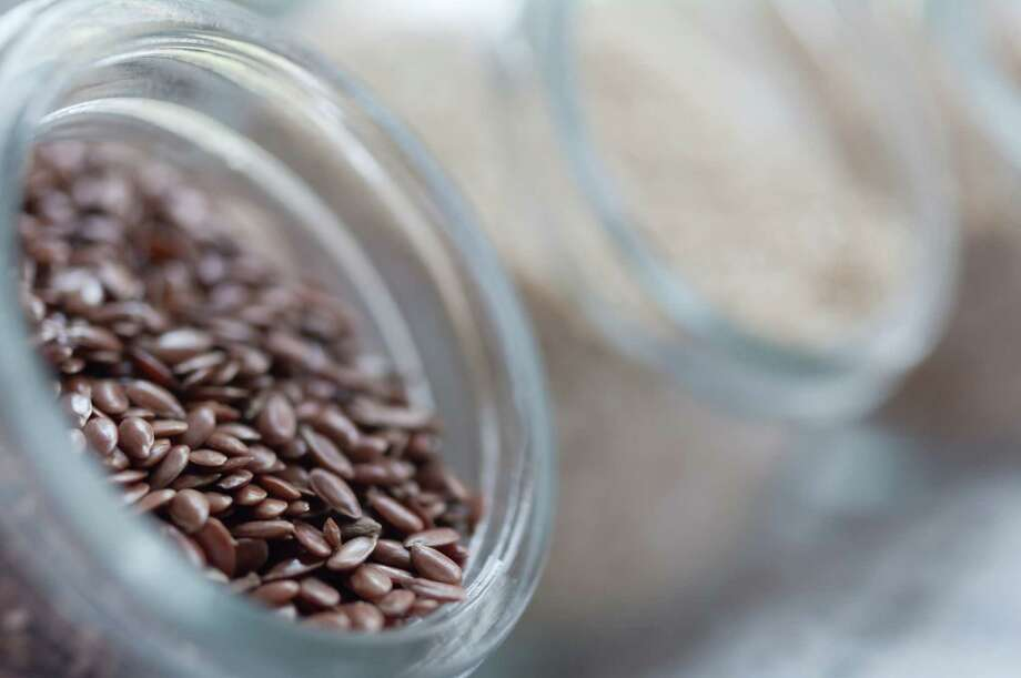 Flaxseeds are filled with omega-3 fats, fiber and lignans (antioxidants), which all benefit heart health. But whole flaxseeds may pass through the intestines undigested, which means you'll miss out on the health benefits inside the seed. Buy ground flax seeds instead, or put them in a coffee or spice grinder. Photo: Gil Guelfucci, Getty Images / Flickr RF