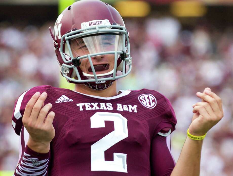 Texas A&M quarterback Johnny Manziel gestures after throwing a touchdown pass against Rice during the fourth quarter at Kyle Field on Aug. 31, 2013, in College Station. Photo: Brett Coomer /Houston Chronicle / © 2013 Houston Chronicle