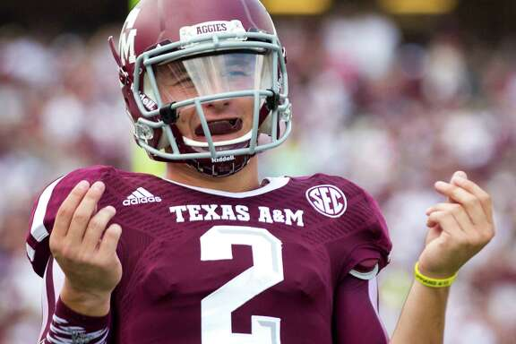 Texas A&M quarterback Johnny Manziel gestures after throwing a touchdown pass against Rice during the fourth quarter at Kyle Field on Aug. 31, 2013, in College Station.