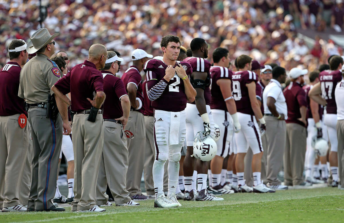 Texas A&M quarterback Johnny Manziel paces the sidelines in the fourth quarter against Alabama at Kyle Field in College Station on Sept. 14, 2013.