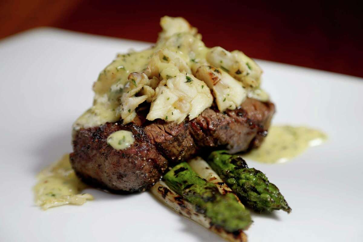 Filet oscar, jumbo lump crab, charred asparagus and béarnaise prepared by Executive Chef Neal Cox at The Manor House at the Houstonian Thursday, Feb. 4, 2016, in Houston, Texas. The Manor House, a historic John Staub landmark, is a private venue for guests of the Houstonian Hotel and members of the Houstonian Club. But this month the hotel has decided to open it to the public for lunch. And in March it is marking the venue's 30th anniversary with a special menu.