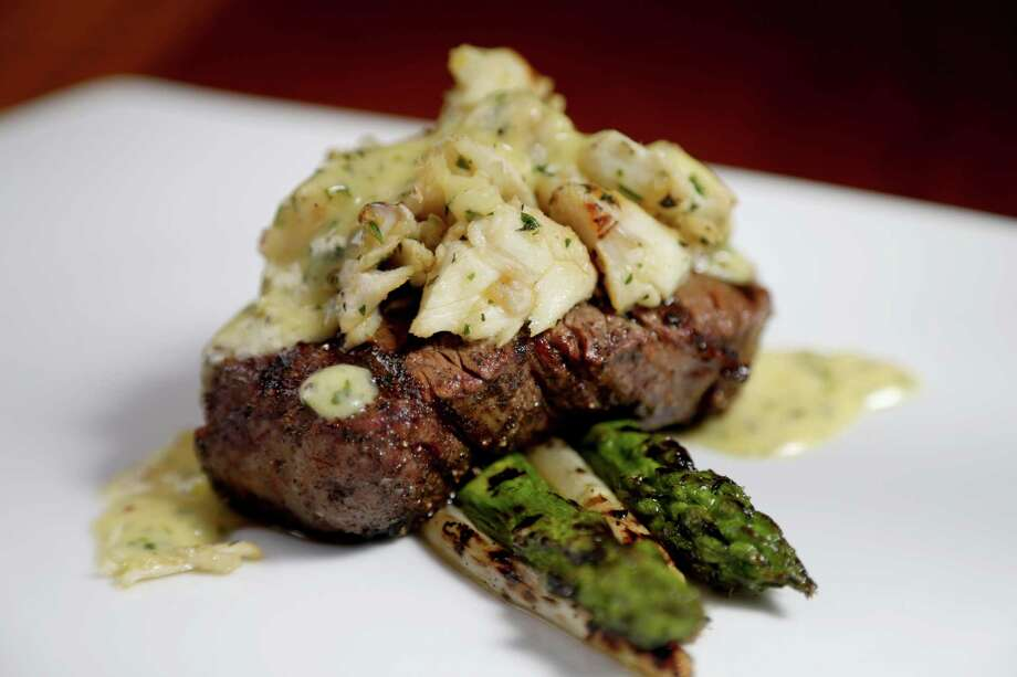 Filet oscar, jumbo lump crab, charred asparagus and béarnaise prepared by Executive Chef Neal Cox at The Manor House at the Houstonian Thursday, Feb. 4, 2016, in Houston, Texas. The Manor House, a historic John Staub landmark, is a private venue for guests of the Houstonian Hotel and members of the Houstonian Club. But this month the hotel has decided to open it to the public for lunch. And in March it is marking the venue's 30th anniversary with a special menu. Photo: Gary Coronado, Houston Chronicle / © 2015 Houston Chronicle
