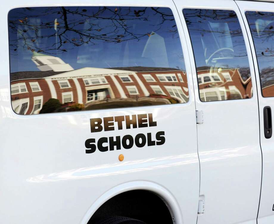 A Bethel School van sits outside the Clifford J. Hurgin Municipal Center on School Street in Bethel, Conn. on Wednesday, Nov. 20, 2013. Photo: Contributed Photo / The News-Times